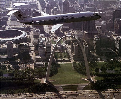Air Force C-9 flying over the Gateway Arch