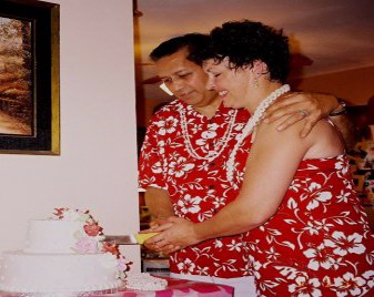 Jess and Linda...cutting their wedding cake during their reception - Sep 4, 2005